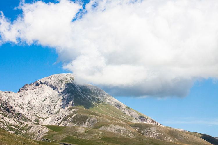 Mountains of the Apennines, during the summer. A cloudy day at about 2000m Cloudy Cloudy Sky Beauty In Nature Blue Sky Clouds Day Height High Italy Landscape Mountain Nature No People Outdoors Peak Scenery Scenics Sky Tranquility