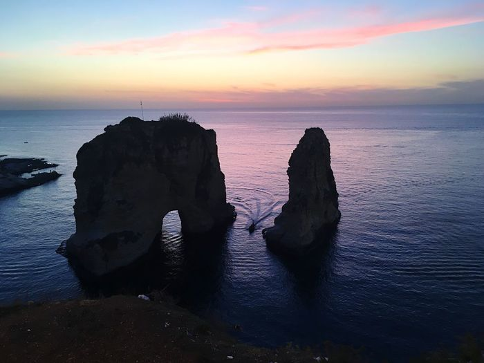 Pigeon rocks in Beirut at sunset Sunset Scenics Pigeon Rocks Holiday Lebanon Beirut EyeEm Selects Water Sea Sky Sunset Beauty In Nature Scenics - Nature Tranquil Scene Tranquility Horizon Over Water Rock Horizon Nature Land No People