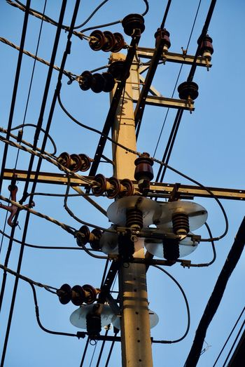 Low Angle View Sky Electricity  Clear Sky Power Supply Technology Cable Nature Connection Power Line  No People Day Fuel And Power Generation Electricity Pylon Outdoors Metal Lighting Equipment Complexity Blue Pole Telephone Line Directly Below Electric Pole