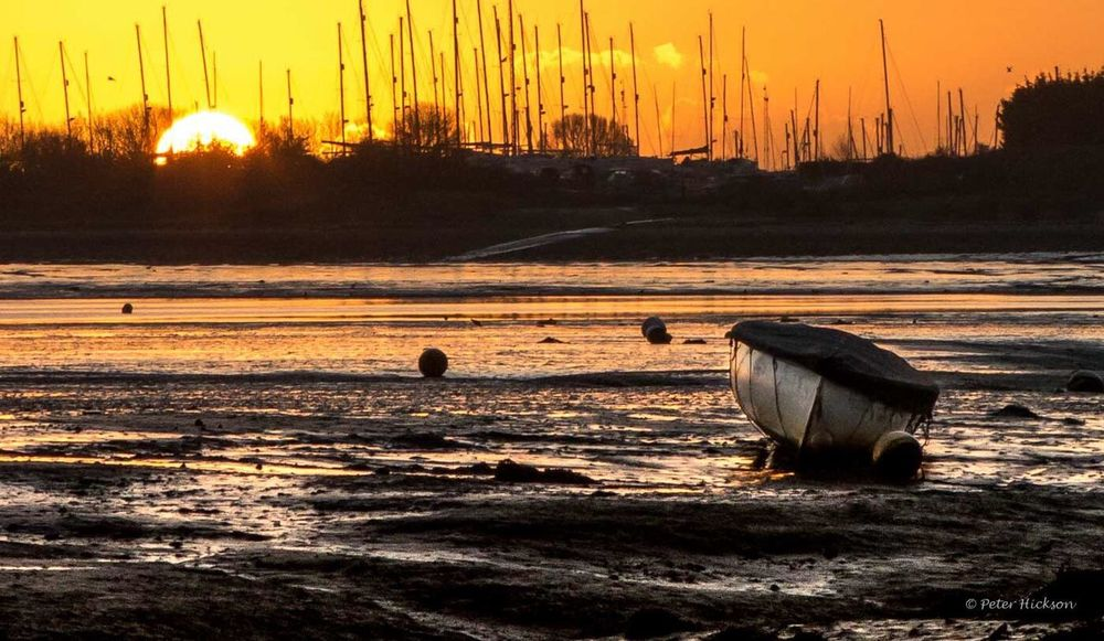 Sunrise and low tide at the marina - Gig Rowing Boat Marina Sunrise Low Tide Mudflats Calm Langstone Harbour  Chichester Harbour Hayling Island