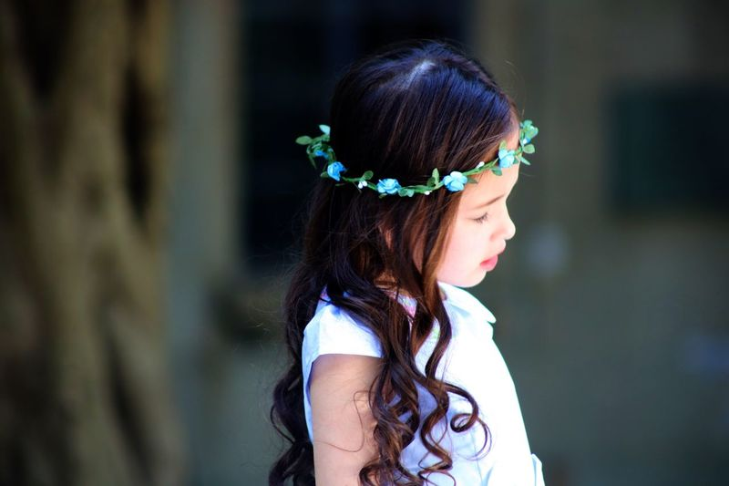 Side view of girl wearing floral wreath