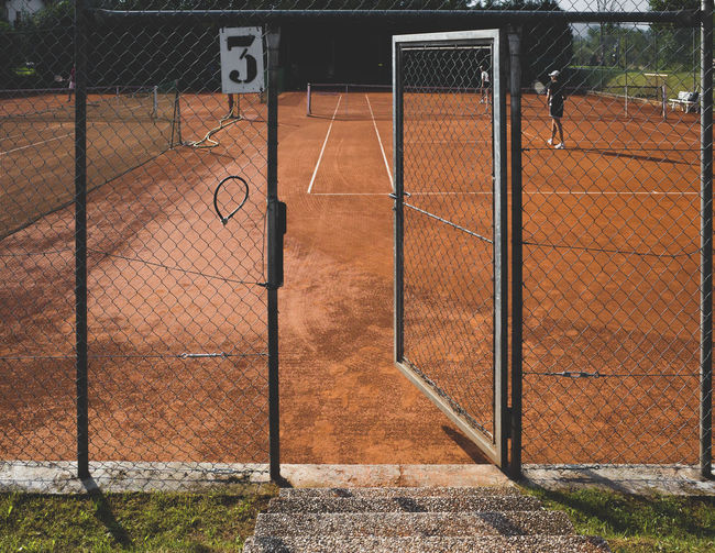 Open gate at tennis clay court
