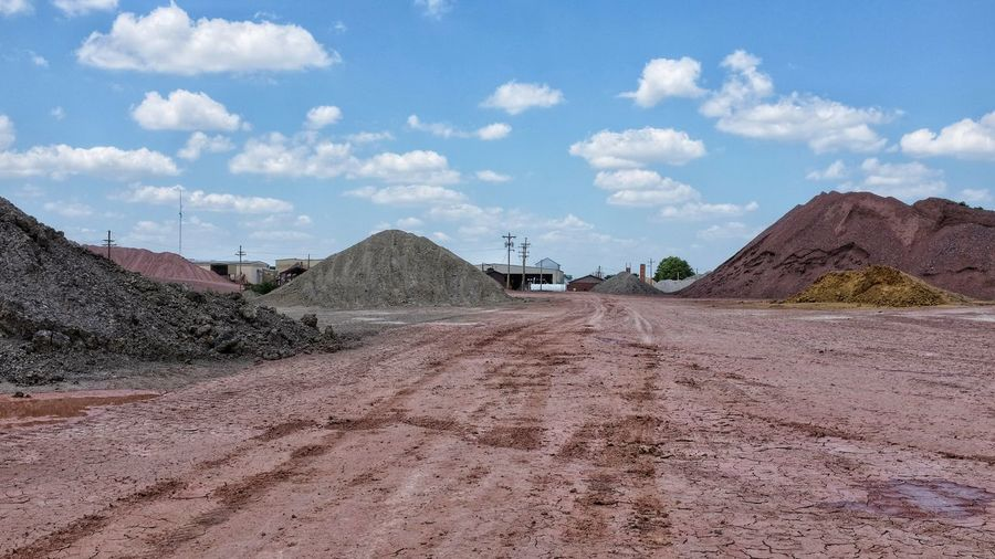 Dirt Road At Open-Pit Mine Against Sky
