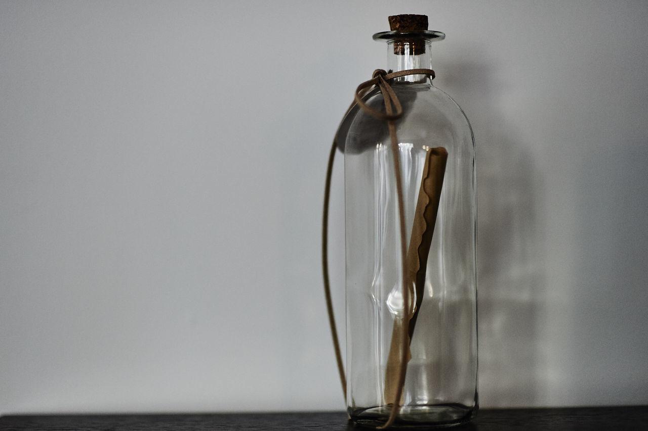 Cinnamon In Glass Jar On Shelf