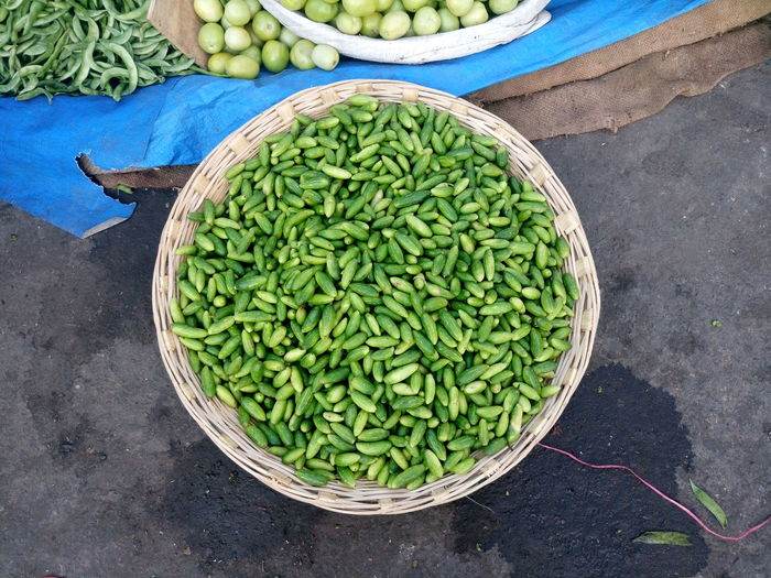 High Angle View Of Ivy Gourds In Basket At Market For Sale