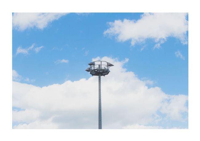 Blue Cloud - Sky Day Light Lonely Low Angle View No People Outdoors Simplicity Sky Streetlights Technology Tranquility