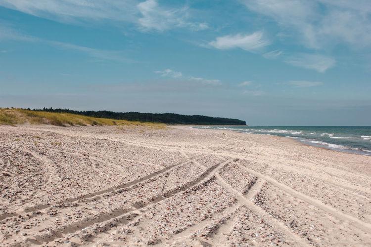 Latvia Latvija Path Beach Beauty In Nature Blue Car Cloud - Sky Day Environment Horizon Horizon Over Water Land Landscape Nature No People Non-urban Scene Outdoors Sand Scenics - Nature Sea Sky Tranquil Scene Tranquility Water