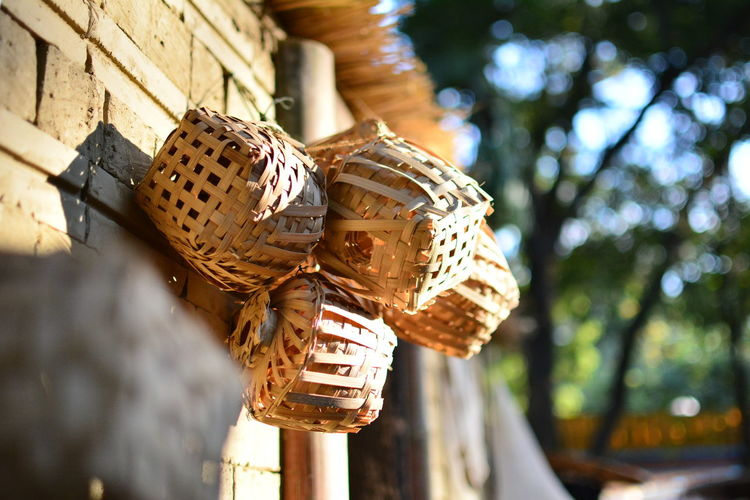 Wicker baskets hanging on wall