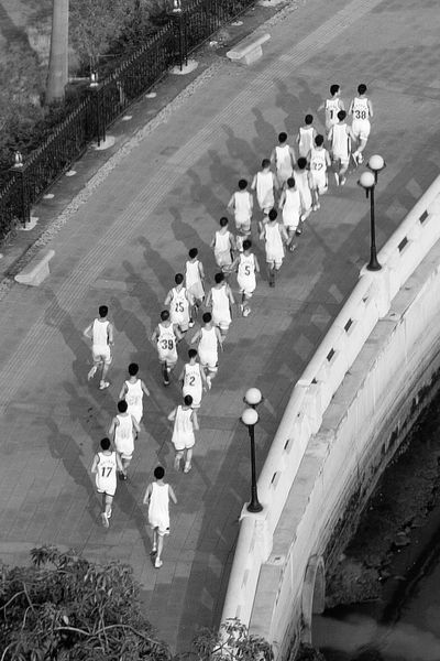 China 2003 Black And White China City Life Group In A Row Men Running Sport Sports Arial Shot