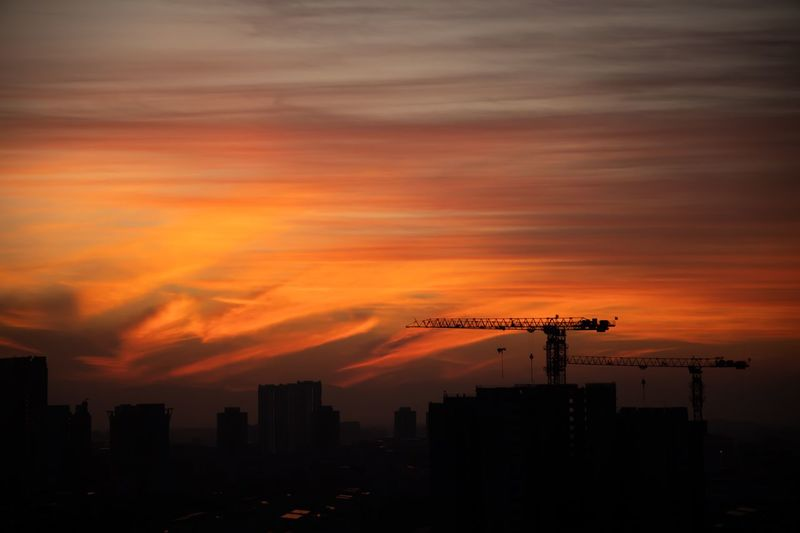 Amazing sunrise over Ang Mo Kio Town Sunset Sky Cloud - Sky Architecture Orange Color Built Structure Silhouette No People City Building Cityscape Construction Industry Dramatic Sky Machinery Crane - Construction Machinery Outdoors