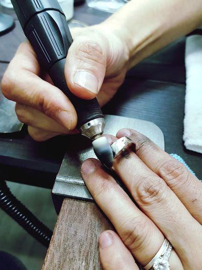 High angle view of woman polishing ring jewelry
