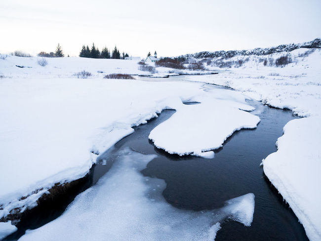 Beauty In Nature Clear Sky Cold Temperature Covering Frozen Iceland Idyllic Landscape Nature Nature Non-urban Scene Remote Scenics Season  Snow Snow Covered Stream Tourism Tranquil Scene Tranquility Water Weather White Color Winter Winter