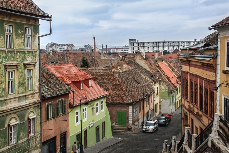 View from the Liar Bridge, Piata Mica, in the historical center of Sibiu, Romania Idyllic City Building Exterior Cultural City City Roadtrip Cityscape Cloud - Sky Day House No People Old Buildings Old But Awesome Old House Old Town Outdoors Residential Building Romania Roof Row House Sibiu Sky Streetphotography Transylvania Travel Destinations Miles Away Secret Spaces The Great Outdoors - 2017 EyeEm Awards Neighborhood Map The Architect - 2017 EyeEm Awards Been There. Stories From The City