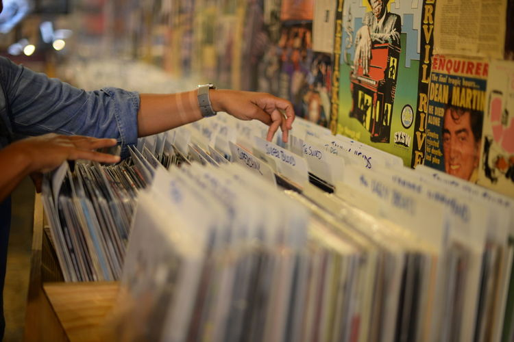 Cropped Image Of Person Searching Vinyl Records At Store