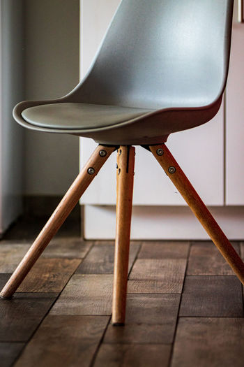 Close-up of chair on hardwood floor