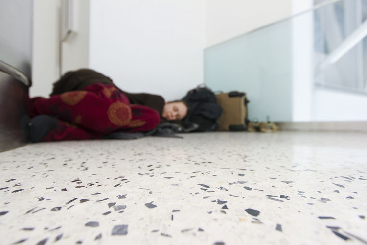 Girl sleeping in her pajamas on an airport floor with her luggage. Sleeping in airports. Traveler problems. Airport Airport Waiting Floor Girl Laying Down Luggage Pajamas Relaxation Resting Selective Focus Sleeping Sleeping In Airports Sleeping On Floor Sleepy Suitcases Surface Level Tired Travel Travel Photography Traveler Traveling Traveller Travelling Original Experiences Night Night, Sleep Tight The Street Photographer - 2017 EyeEm Awards