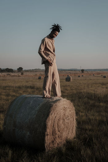 dawn wrapped in a bale series // The Great Outdoors - 2019 EyeEm Awards The Portraitist - 2019 EyeEm Awards Conceptual Concept Desert Canola Hay Bale Dusk Dawn EyeEm Best Edits EyeEm EyeEm Gallery EyeEm Nature Lover EyeEm Selects EyeEm Best Shots Editorial  Performance Actor Fashion Fashion Photography Fashion Model Outdoors Day Full Length Standing Agriculture Environment One Person Hay Casual Clothing Farm Rural Scene Clear Sky Grass Nature Bale  Plant Field Landscape Land Sky Bale  Real People Lifestyles