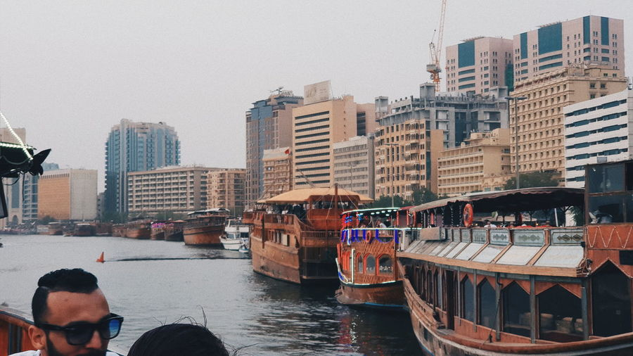 Building Exterior Architecture Built Structure Water Nautical Vessel Transportation Mode Of Transportation City Building Sky Nature Day Waterfront Real People Clear Sky Group Of People Residential District City Life Lifestyles Canal Outdoors Passenger Craft Office Building Exterior Cityscape Sailboat