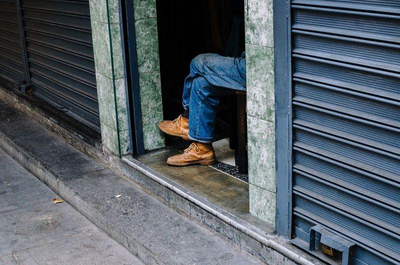 Man seen through closed door of window