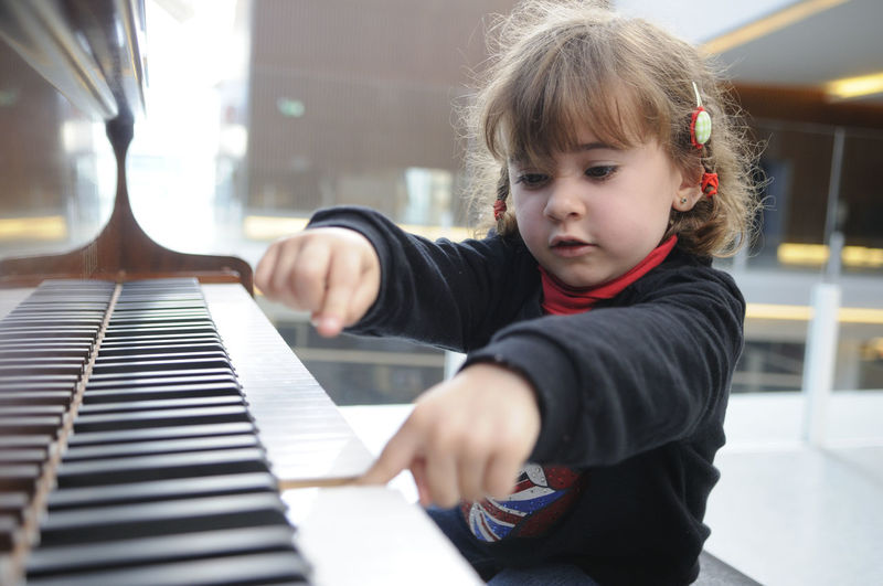 Adorable little girl having fun playing the piano Childhood Child Musical Equipment One Person Real People Piano Musical Instrument Innocence Boys Indoors  Males  Playing Looking Cute Leisure Activity Music Sitting Lifestyles Men Piano Key