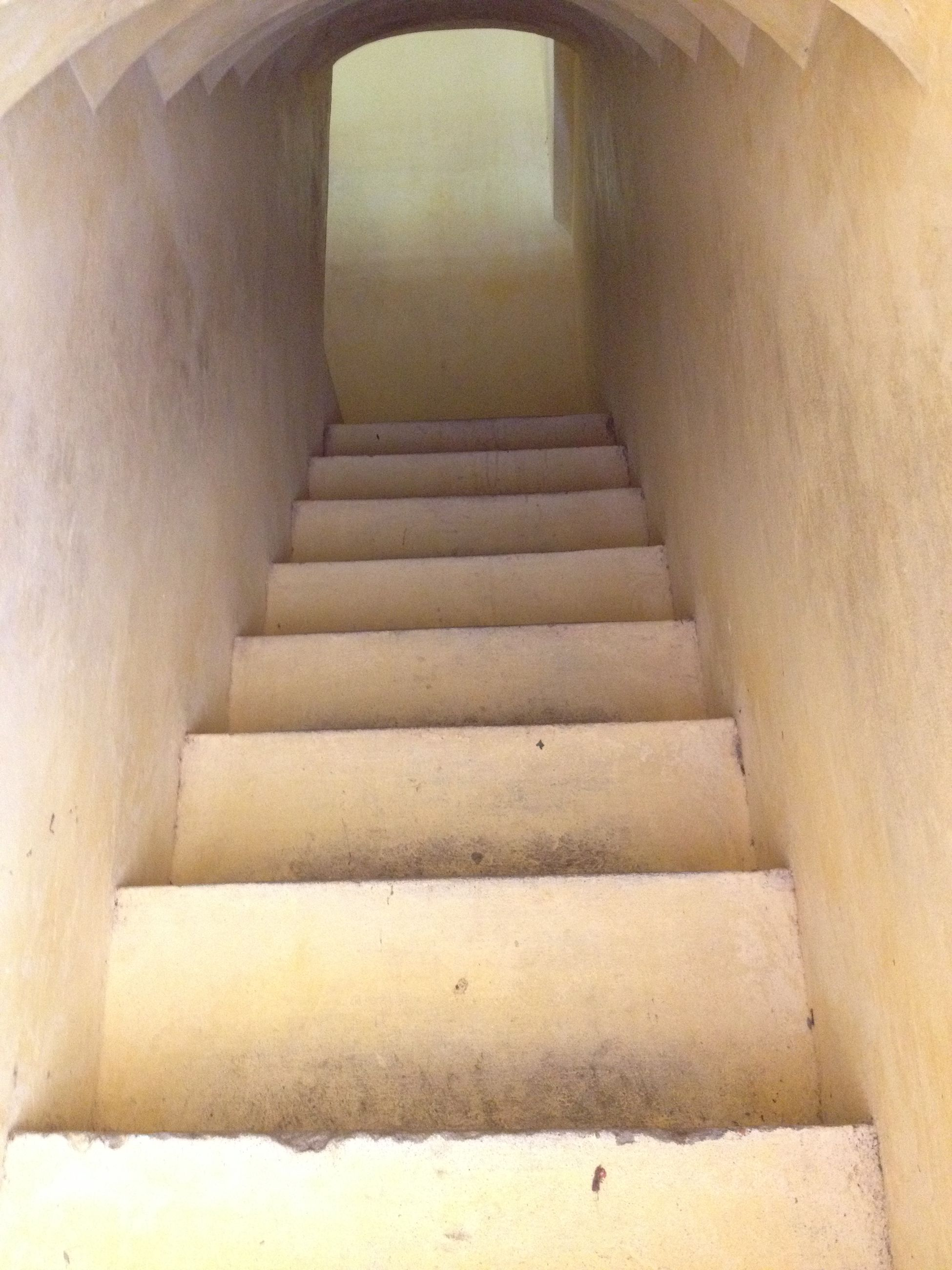 architecture, built structure, indoors, wall - building feature, corridor, wall, building, the way forward, steps, building exterior, in a row, steps and staircases, staircase, diminishing perspective, sunlight, no people, narrow, day, old, absence