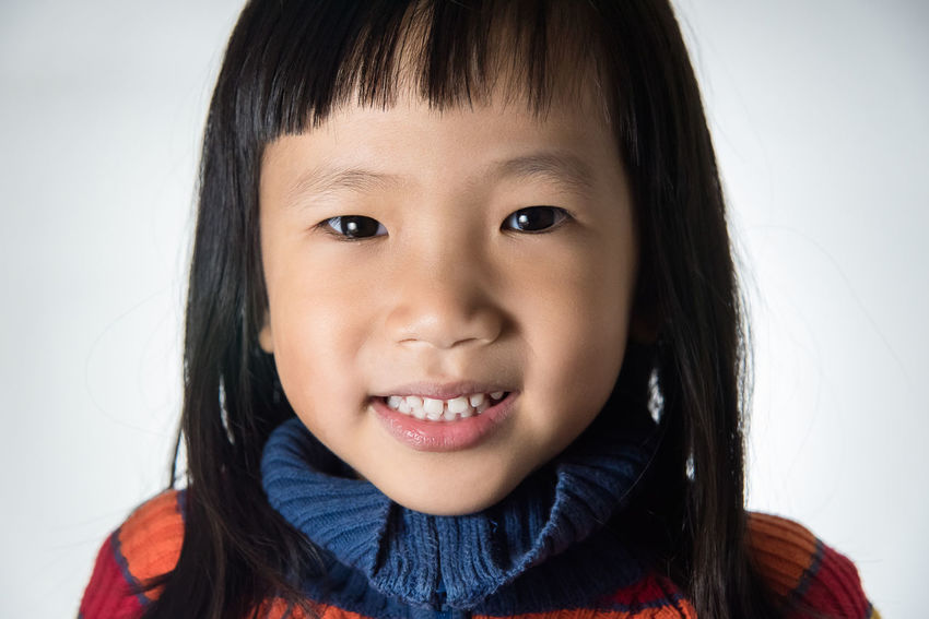Headshots Looking At Camera Asian Girl Black Hair Cheerful Child Childhood Children Only Close-up Cute Day Front View Happiness Headshot Human Body Part Human Face Indoors  Innocence Little Girl Looking At Camera One Person People Portrait Real People Smiling