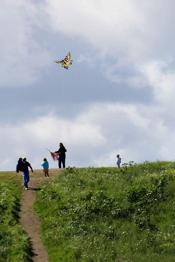 White Beard Man Walks Down The Hill Woman And Girls Flying A Kite Enjoying Life EyeEm Gallery Peaceful Walk Spending Time With Kids Windy Day Check This Out Eye4photography  Eyem Nature Lovers  White Hair Mature Spring