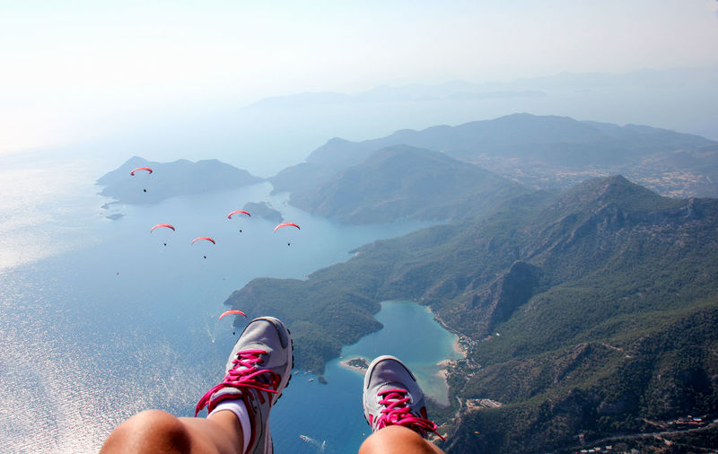 Adrenaline Adrenaline Junkie Paragliding View Beauty In Nature Body Part High Angle View Human Body Part Human Foot Human Leg Island Leisure Activity Lifestyles Low Section Mountain Mountain Range Nature One Person Outdoors Personal Perspective Real People Scenics - Nature Shoe Water Women