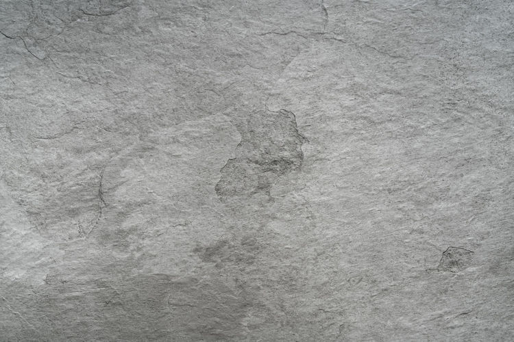 High angle view of footprints on rock
