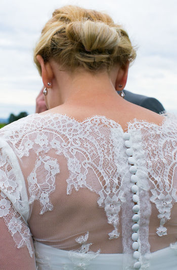 Bottons Beach Blond Hair Bride Close-up Day Focus On Foreground Full Frame Lace - Textile Leisure Activity Lifestyles Nature Neck One Person Outdoors Real People Rear View Sky Water Wedding Wedding Day Wedding Dress Young Adult Young Women