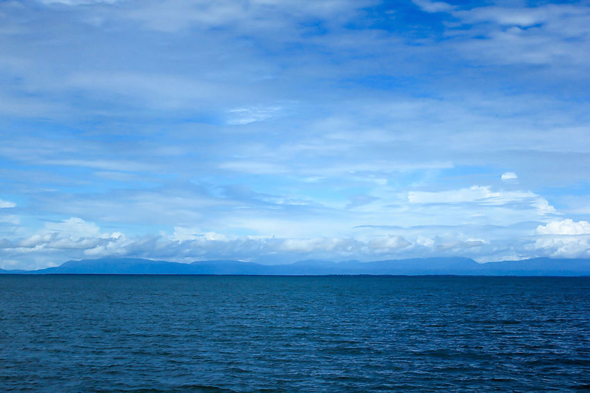 Sea View Clouds in the Sky on a Bright Day Landscapes And Lakeviews Travel Beauty In Nature Blue Cloud - Sky Day Horizon Horizon Over Water Idyllic Landscape Landscape Sea Mountain Nature No People Non-urban Scene Outdoors Scenics - Nature Sea Sky Tranquil Scene Tranquility Water Waterfront