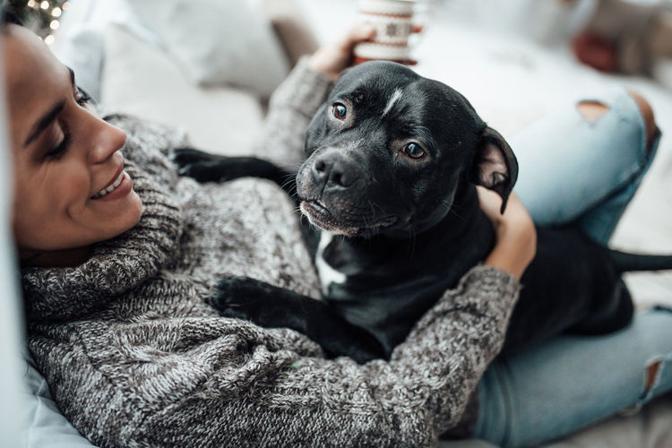 Man with dog relaxing at home