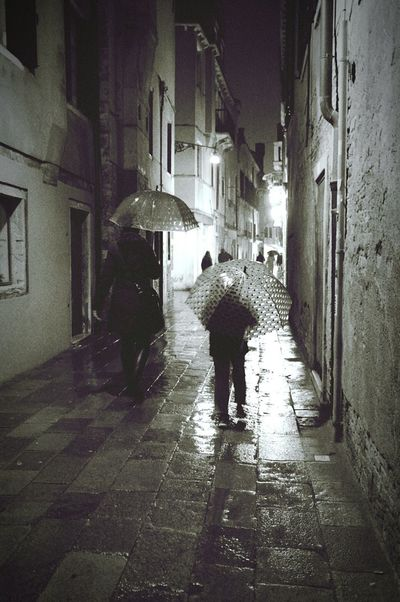 Umbrella Rain Night Bw Venice Italy Dark Built Structure Walking Architecture Real People Rear View Building Exterior The Way Forward Wet City Life People Night City