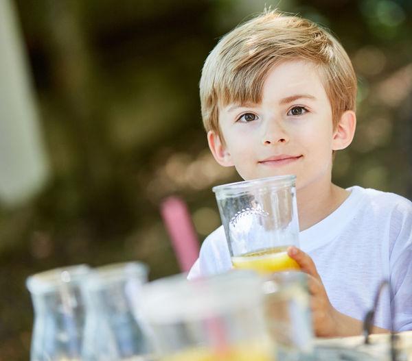 Portrait of boy drinking drink