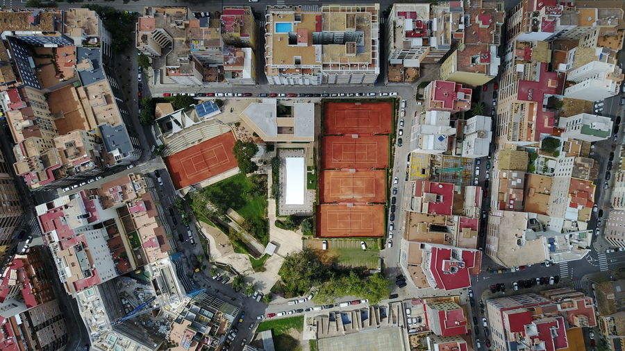 High angle view of street amidst buildings in town