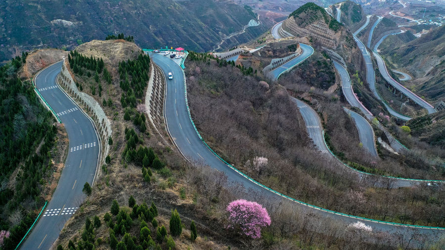 Road Transportation High Angle View Aerial View Mountain Road Day Scenics - Nature Plant Car Nature Curve No People Motor Vehicle Mode Of Transportation Tree Mountain Architecture Beauty In Nature Built Structure Winding Road Outdoors