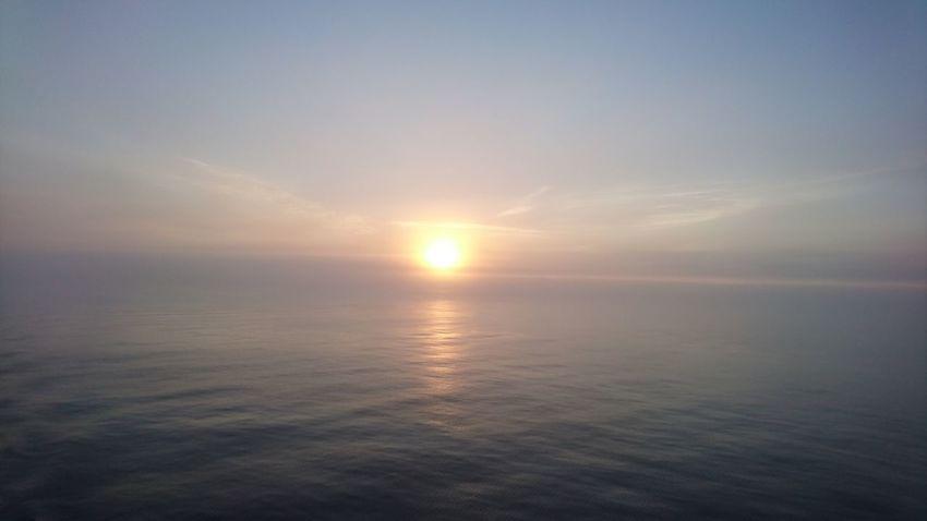 Sunset Reflection Beauty In Nature Water Sunlight Sky Idyllic Horizon Over Water No People
