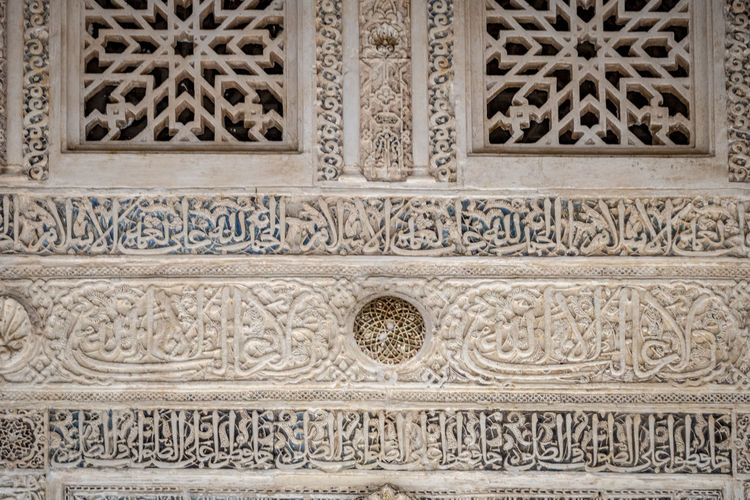 GRANADA, SPAIN - October 11, 2018: The famous Alhambra in Granada, Spain. It is a palace and fortress complex located in Granada. Granada SPAIN Alhambra Alhambra De Granada  Architecture Arabic Style Ancient Architecture Mosque Architecture Interior Design Pattern Design No People Built Structure Ornate Art And Craft History Craft The Past Building Exterior Carving - Craft Product Creativity Travel Destinations Intricacy Bas Relief Carving