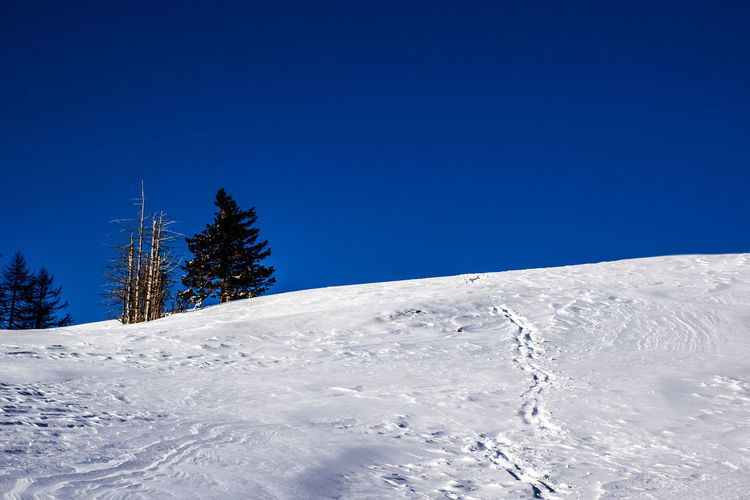 View of snowcapped mountain against clear blue sky