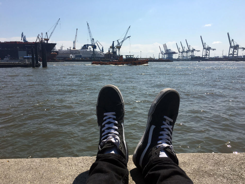 Blue Commercial Dock Container Port Crane - Construction Machinery Day Development Docks Hamburg Hamburger Hafen Harbor Harbor Low Section Lunchbreak Nature Outdoors Person Personal Perspective Rippled Sea Shoe Sky Tranquil Scene Tranquility Vacations Water