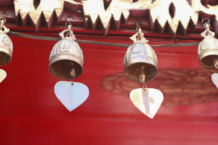 Close-up of electric lamp hanging in temple