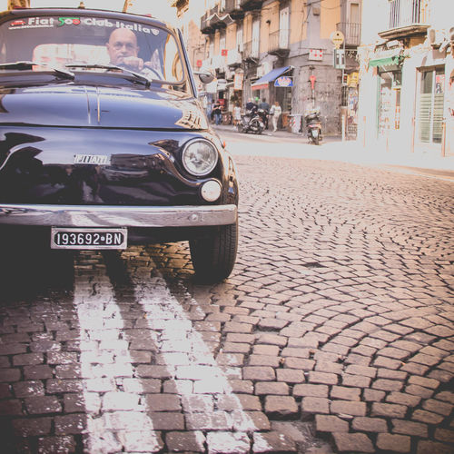 Naples Italy❤️ South Italy City Street Streetphotography Architecture Building Exterior Day Outdoors Footpath Paved Mode Of Transportation Transportation Car Land Vehicle Motor Vehicle Built Structure Cobblestone Incidental People Retro Styled Vintage Car Stationary Paving Stone Fiat500 Fiat Fiat 500 Road Paved Road One Person Angry