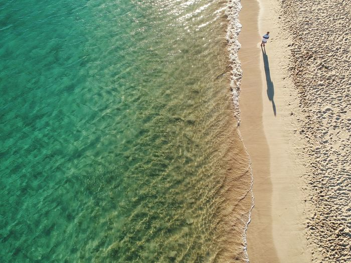 Fuerteventura Canary Islands Sand Beach Beautiful Blue Sea Alone Dronephotography Drone  Water Sunlight Beach High Angle View Day Nature Land Sea Beauty In Nature Real People Outdoors Reflection Waterfront Tranquility People Scenics - Nature Shadow Motion Leisure Activity