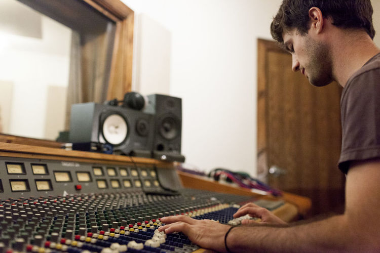 Audio engineer working at mixing board