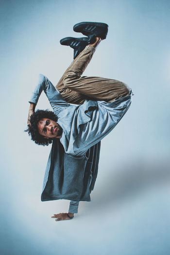 Dance Breakdance Looking At Camera Movement One Person Portrait Real People Studio Shot Young Adult
