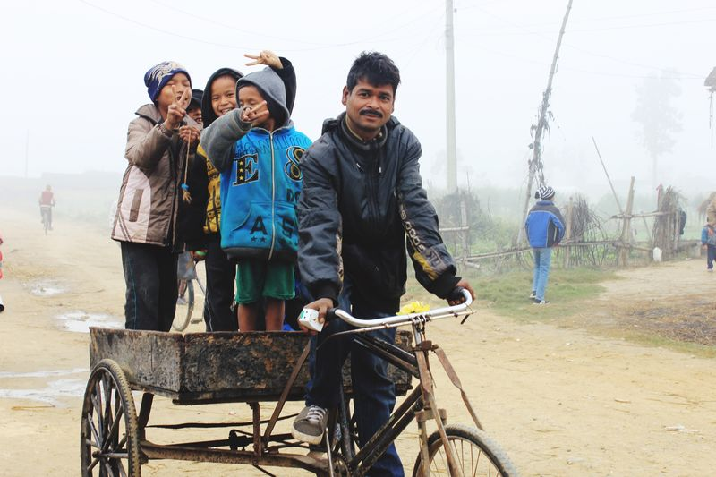 EyeEmNewHere EyeEm Selects Happiness Is Every Where Real People Kids Enjoying Bicycle Ride Mid Adult Men Winter Misty Morning Cold Temperature Enjoying The Moment Happiness #followme #brunette Pose For The Camera Nepal #travel