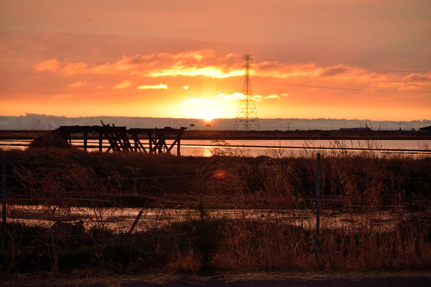 Sunset At Eden Landing 14 Marsh Tidal Wetlands Restored Marshlands Eden Landing Ecological Reserve Wildlife Refuge Salt Pond Delapidated Pier Sundown Sunset Sun's Glow Sunset_collection Sunset Silhouettes Power Pylon & Lines Telephone Poles Fog Marine Layers! Reflection Reflections In The Water Buildings Native Grasses Landscape Nature Nature_collection Beauty In Nature Landscape_Collection Landscape_photography Reed - Grass Family Dramatic Sky Horizon Over Water Fence