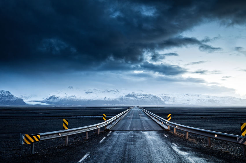 Iceland's Ring Road near Skaftafell National Park. Road Less Travelled Cloud - Sky Deserted Diminishing Perspective Direction Dramatic Sky Environment Isolation Mountain Mountain Range Nature No Cars  No People No People, Outdoors Rain Ring Road Scenics - Nature Sky Storm The Way Forward Transportation Travel