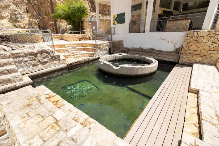 High angle view of swimming pool by building