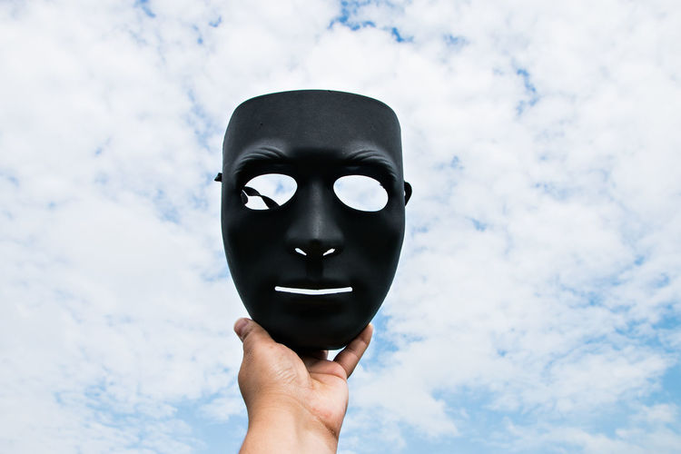 black mask anonymous Art And Craft Body Part Cloud - Sky Day Disguise Finger Hand Holding Human Body Part Human Face Human Hand Human Representation Lifestyles Low Angle View Mask Mask - Disguise Nature Obscured Face One Person Real People Sky Unrecognizable Person